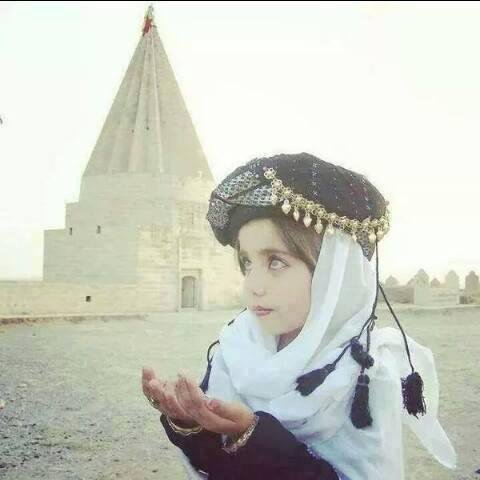A Yazidi girl praying