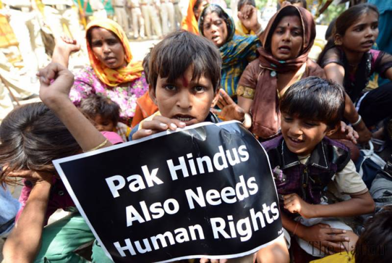 Minority Hindus demonstrating. Poster saying Pak Hindus also need Human Rights.