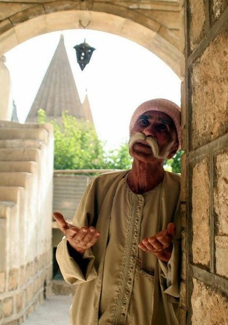 Yazidi man praying