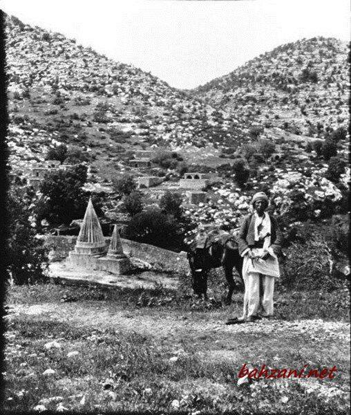 A Yazidi standing near a temple