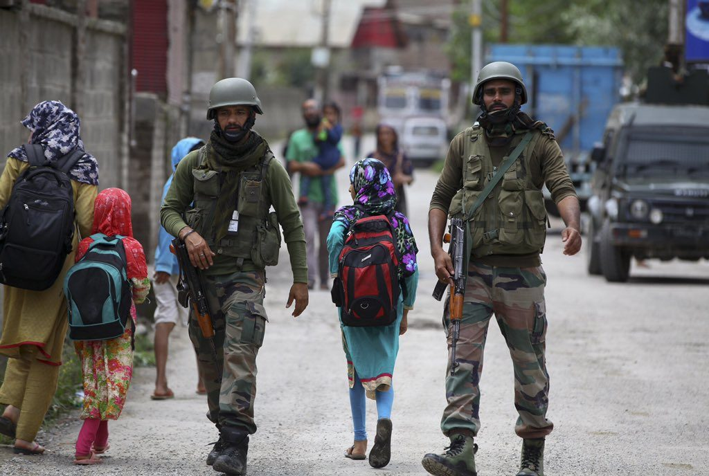 Kids going to School in Kashmir under the protection of Paramilitary.