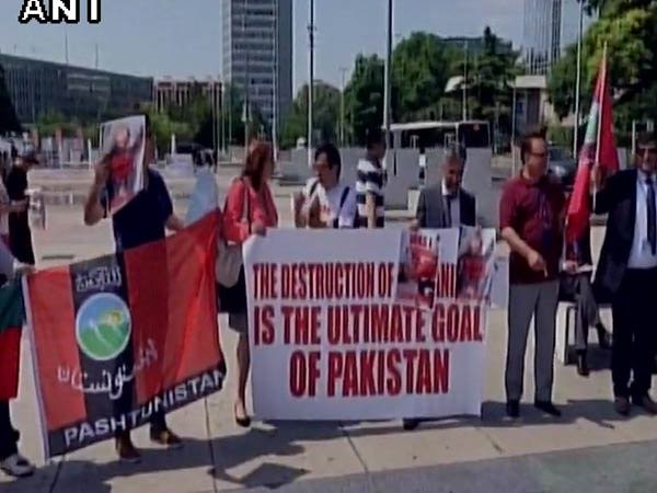 "Demonstrators outside UN Human Rights Conference at Geneva holding Banners of ""Pashtunistan"" and protesting against Pakistan Army Atrocities and Genocide."