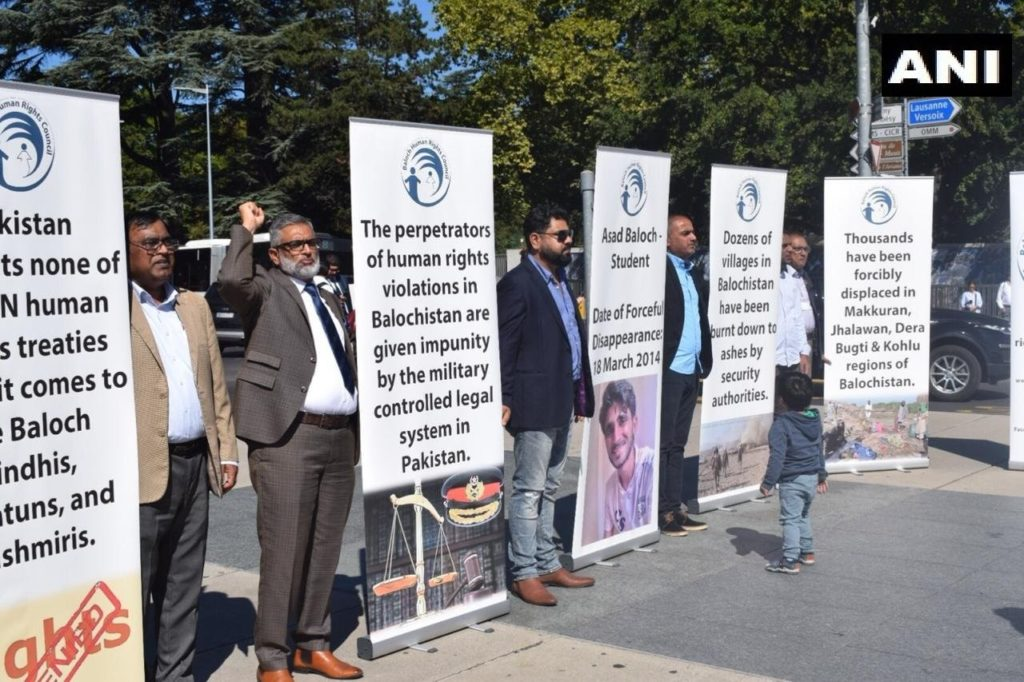 Baloch people exposing Pakistan Hypocrisy on Balochistan at UN Geneva. They protested with their banners on Human Rights violations in Balochistan by Pakistan Army and demanding that Pakistan Army be tried for War Crimes.