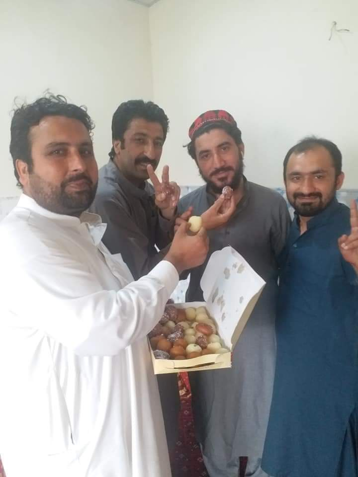 PTM workers distributing sweets after the news of release of 2 elected PTM MNAs Mohsin Dawar and Ali Wazir on bail