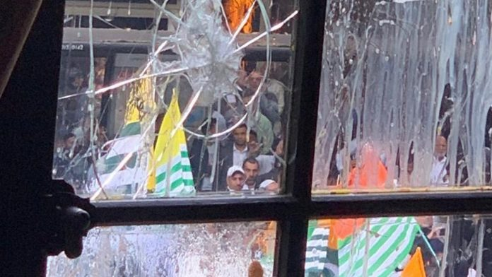 Broken window pane after violent protests by Pakistanis in the name of Kashmir in Sadiq Khan's Londonistan