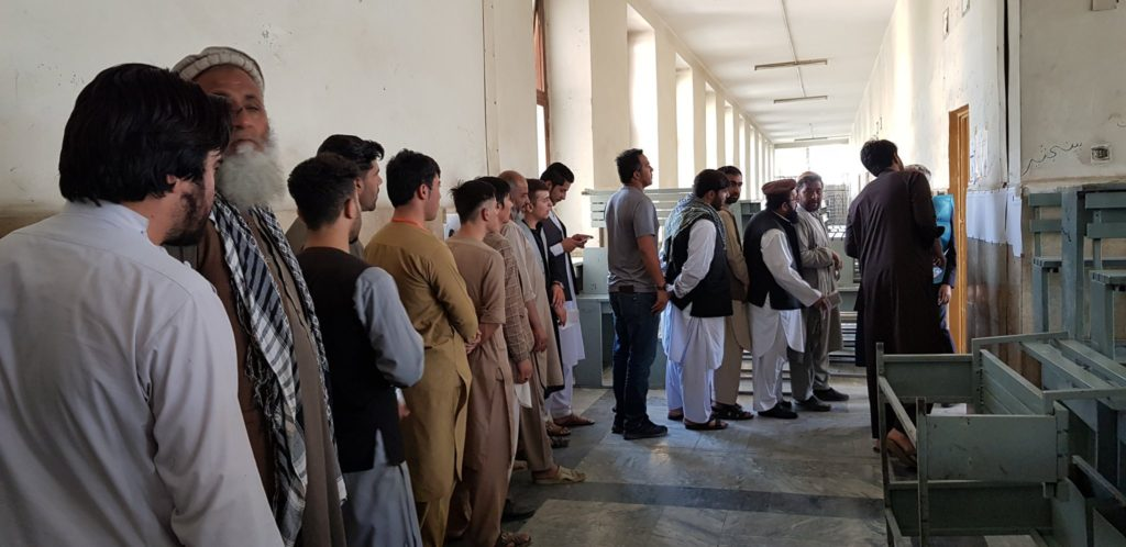 Afghan Election 2019:  Men queuing outside the Polling Station to cast their votes despite Taliban Terrorist Threats