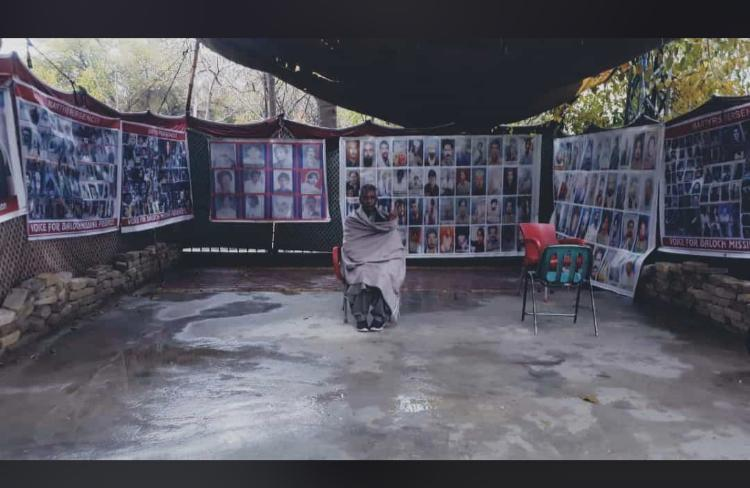 Atrocities By Pakistan Army:  Mama Qadeer Baloch who is a Human Rights Activist and, Vice President of NGO Voice of Baloch Missing Persons (VBMP) sitting with pictures of Some of the Baloch youth who were disappeared by Pakistan Army
