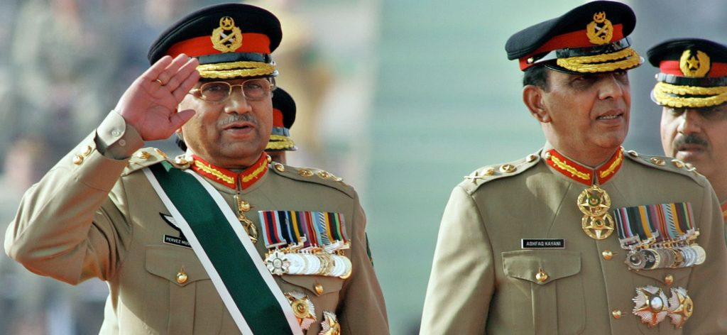 On November 28, 2007, then Pakistani President Pervez Musharraf (L) salutes as he arrives with then newly appointed army chief General Ashfaq Kiyani during the change of command ceremony in Rawalpindi
