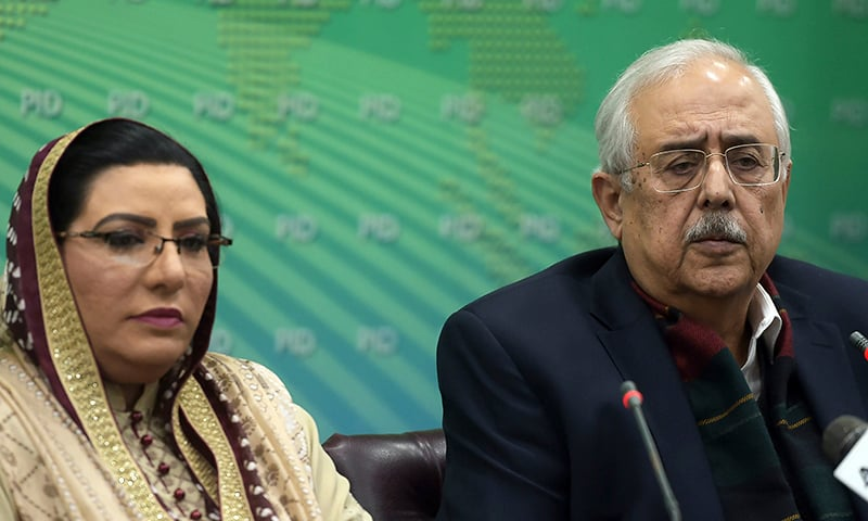 Pakistan's Attorney-General Anwar Mansoor Khan (R) speaks during a press conference along with Special Assistant to the Prime Minister for Information and Broadcasting, Firdous Ashiq Awan following a special court verdict against Ex-Army Chief General Pervez Musharraf , in Islamabad on December 17, 2019.