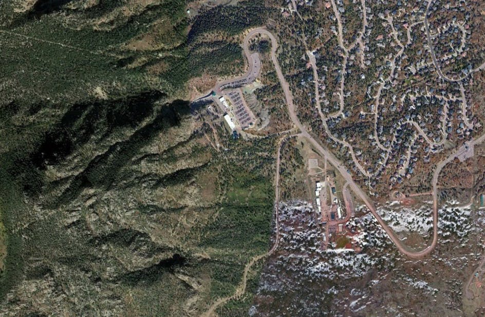 A satellite image of Cheyenne Mountain Air Force Station, with the long snaking road that leads to its main entrance.