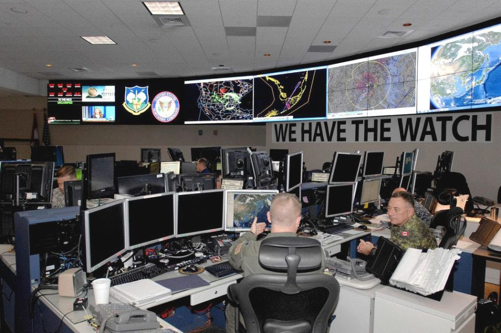 "A view inside NORAD's primary command center at Peterson Air Force Base. NORAD's motto is ""We Have The Watch."""