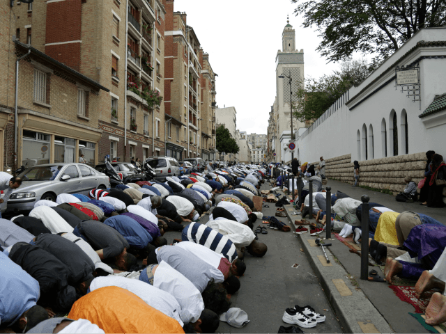 Muslims offer Eid al-Fitr prayers outside the Grande Mosquee de Paris (Great Mosque of Paris) in Paris on June 25, 2017. Eid al-Fitr festival marks the end of the holy Muslim fasting month of Ramadan during which devotees are required to abstain from food, drink and sex from dawn to …